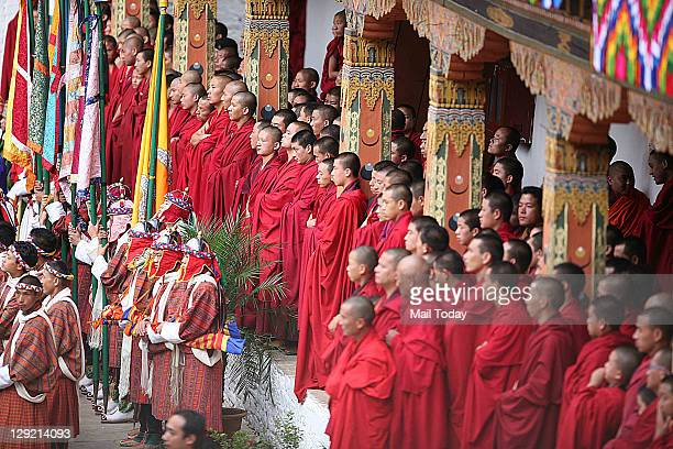 Buddhist Monks wait to take part in the wedding ceremony of Bhutan King Jigme Khesar Namgyal Wangchuck and Queen Jetsun Pema at Punakha Dzong in...