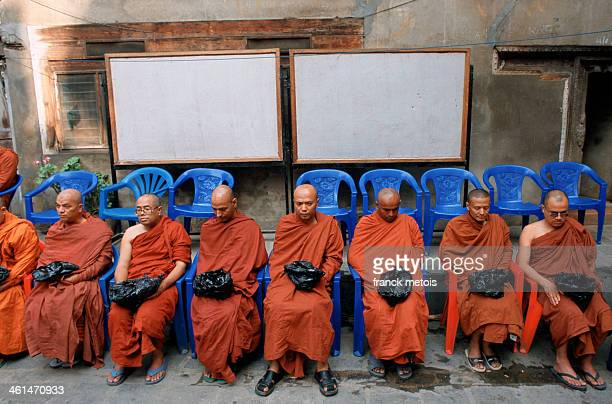 Buddhist monks waiting for alms during a Newari festival