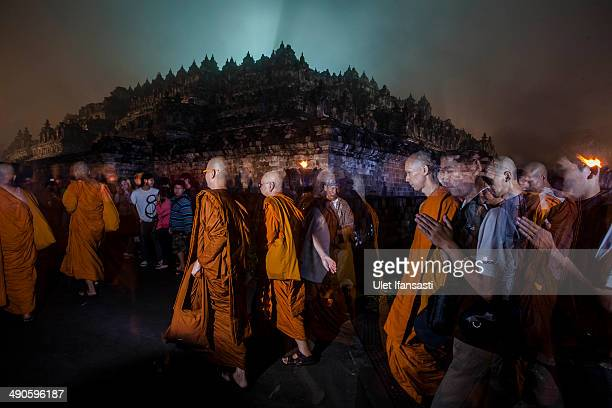 Buddhist monks walk around the Borobudur temple during celebrations for Vesak Day on May 15 2014 in Magelang Central Java Indonesia Vesak is observed...