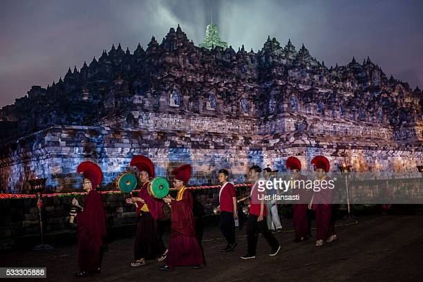 Buddhist monks walk around the Borobudur temple during celebrations for Vesak Day on May 22 2016 in Magelang Central Java Indonesia Vesak is observed...