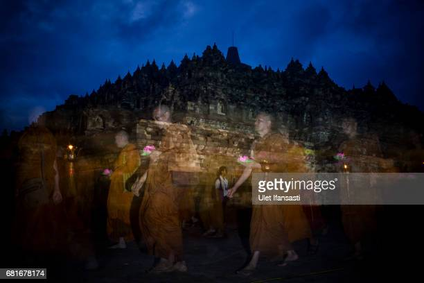 Buddhist monks walk around the Borobudur temple during Pradaksina procession as a part of celebrations for Vesak Day on May 11 2017 in Magelang...