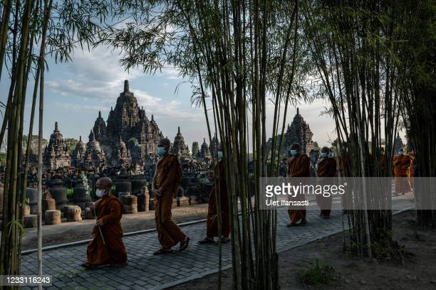 Buddhist monks walk around the Buddhist Sewu temple during Pradaksina procession as a part of celebrations for Vesak Day on May 26, 2021 in...