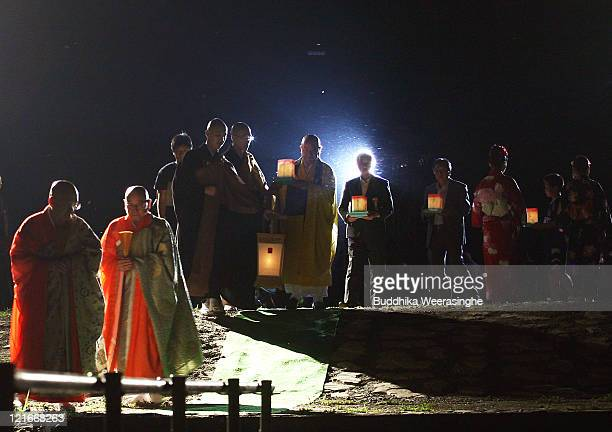 Buddhist Monks walk to float the lanterns during celebrations for the Obon Festival honouring the spirits of deceased ancestors at Eiheiji on August...