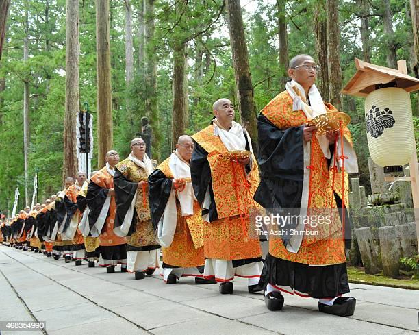 Buddhist monks walk toward Torodo Hall of Okunoin to hold a memorial ceremony to mark the 1200th anniversary of Mount Koya on April 2 2015 in Koya...