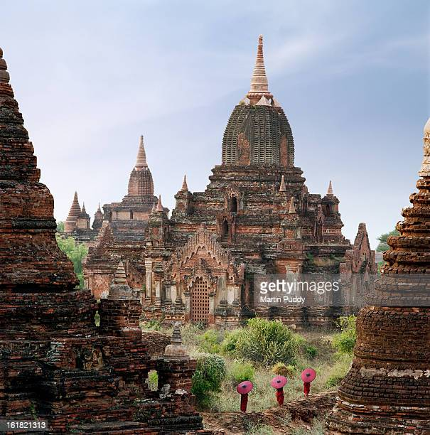 Buddhist monks walking past temple