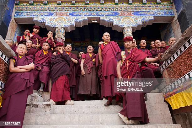 CONTENT] Buddhist monks watching rehearsal of the dancing monks before Tse Chu Hemis festival in Ladakh Himalaya in North west India