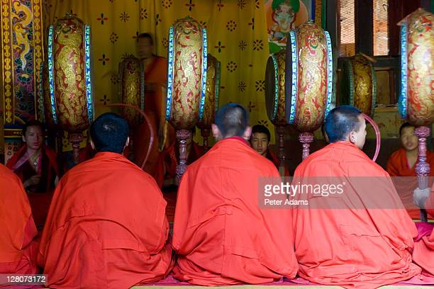 buddhist monks with drums, trongsa dzong or monastery, trongsa, bhutan - trongsa district stockfoto's en -beelden