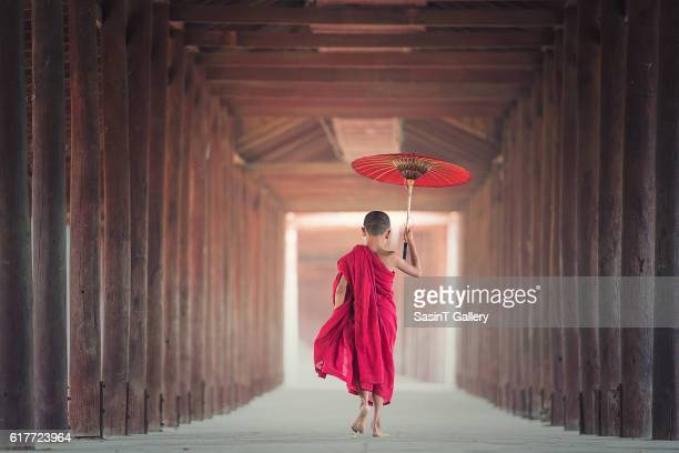 Buddhist novice is walking in temple