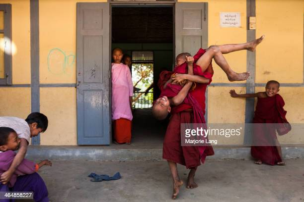CONTENT] Buddhist novice monks and nuns playing around in a school near Mandalay Myanmar