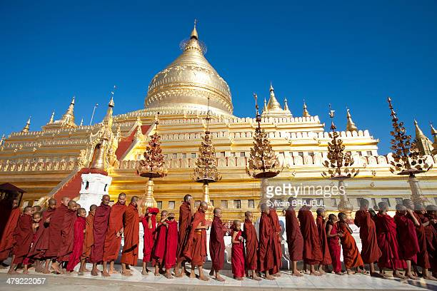 CONTENT] Buddhist novices in front of the Shwezigon pagoda during a festival in Bagan or Pagan Burma or also called Myanmar