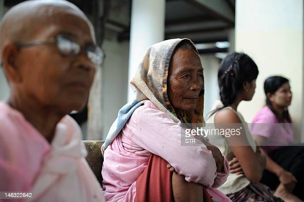 A Buddhist nun and Rakhine people stay at a monastery used as a temporary shelter for people displaced by days of violence in Sittwe capital of the...