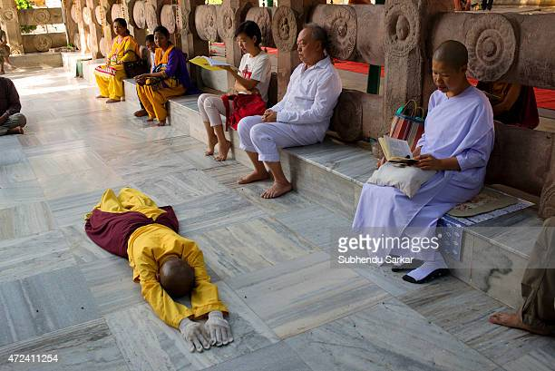 Buddhist nun lies prostrate in prayer at Mahabodhi temple complex as a part of Buddha Purnima celebrations at Bodh Gaya the place where lord Buddha...