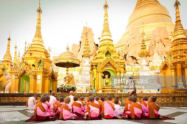 CONTENT] Buddhist nuns are praying before the pavilions of Shwedagon Complex in Yabgon Myanmar on May 05 2013