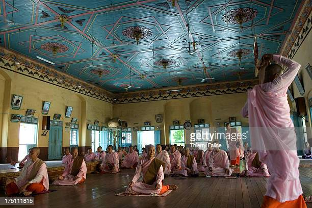 Buddhist nuns gather for a prayer in a room at the Thanbodday Pagoda Located about 20 km from Monywa town Thanbodday Pagoda dates from the 14th...