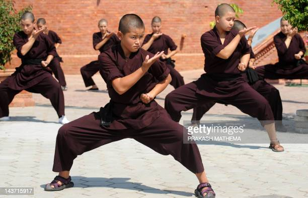 Buddhist nuns practise Kungfu at the Amitabha Drukpa Nunnery on the outskirts of Kathmandu on April 26 2012 Buddhist nuns in the Himalayas have...
