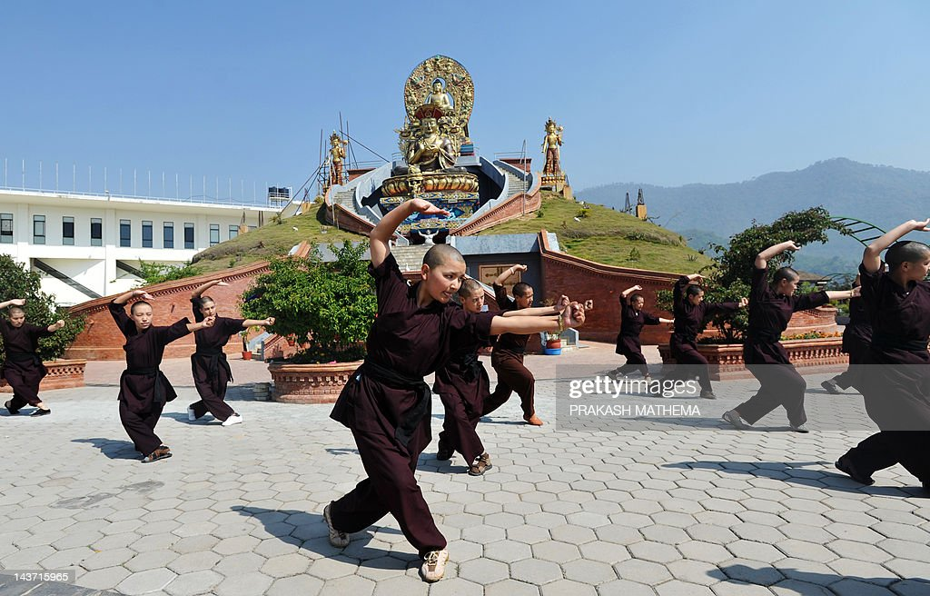 Buddhist nuns practise Kung-fu at the Am : News Photo
