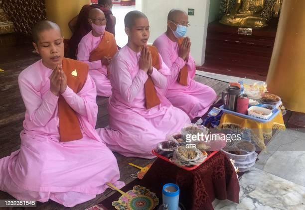 Buddhist nuns pray at Shwedagon pagoda following the Thingyan festival that marks the Burmese New Year in Yangon on April 17, 2021.
