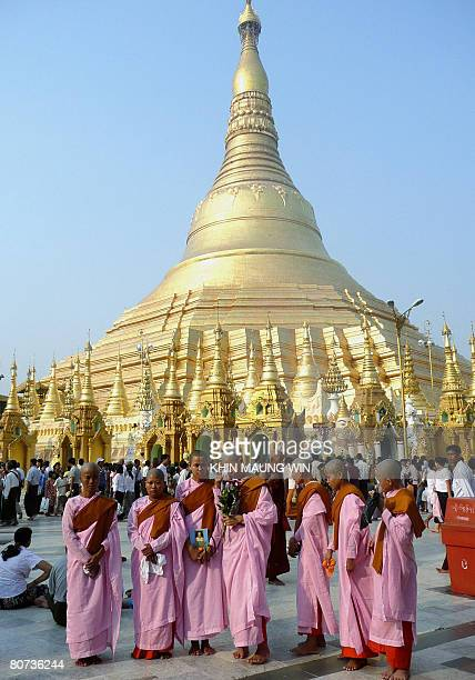 Buddhist nuns visit Myanmar's famous Shwedagon Pagoda in Yangon on April 17 2008 A week long festivities of the Buddhist New Year ended in Myanmar...