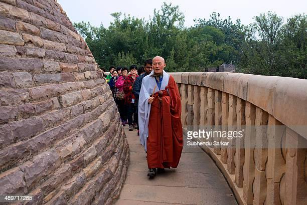 Buddhist pilgrims performing rituals
