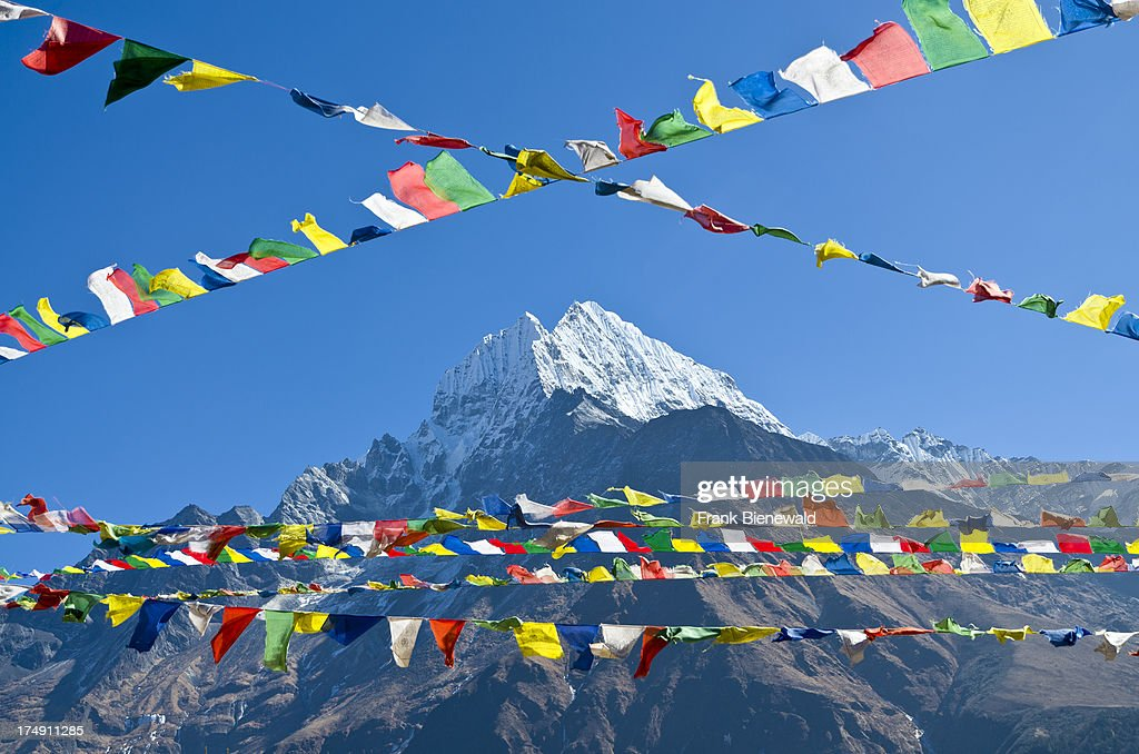 Buddhist prayer flags in front of Kangtega Mountain above... : News Photo