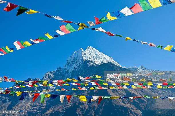 Buddhist prayer flags in front of Kangtega Mountain above Namche Bazar the base for trekking and mountaineering in Solo Khumbu region