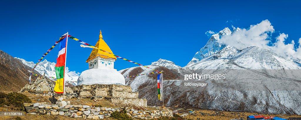 Buddhist prayer flags stupa shrine high in Himalayan mountains Nepal : Stock Photo