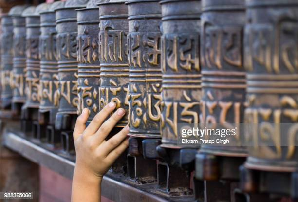 buddhist prayer wheels in a temple in nepal, kathmandu. - karma stock photos and pictures