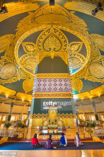 buddhist praying in ouparta thandi zedi pagoda - naypyidaw stock pictures, royalty-free photos & images