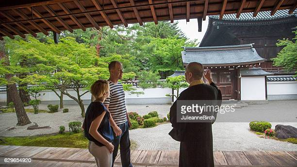 Buddhist Priest explaining to tourists