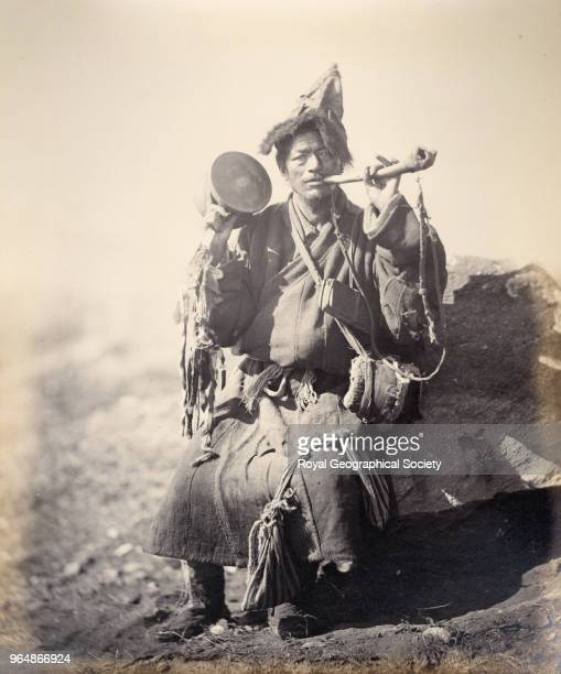 Buddhist priest of Bhotan with a horn which is made from human thighbone Bhutan Myanmar 1860