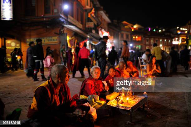 Buddhist Priest offering rituals at Boudhanath Stupa during celebration the 2562 Buddha Purnima festival Birth Anniversary of Lord Gautam Buddha at...