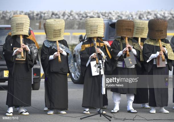 Buddhist priests play shakuhachi in Iwaki northeastern Japan on March 11 to commemorate the seventh anniversary of the 2011 earthquake The earthquake...
