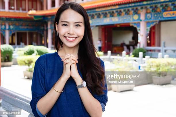 buddhist religion concept,religious asian buddhist woman praying - 懇願する ストックフォトと画像