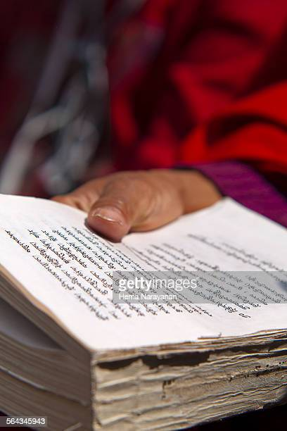 buddhist scriptures - hema narayanan stock pictures, royalty-free photos & images