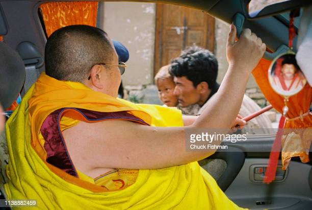 Buddhist spiritual leader of Bhutan Trulku Jigme Chode blessing people from the car taking him along the route from the capital city Thimphu to his...