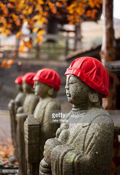 buddhist statues, bodhisattva, o-jizo san statues - jake warga stock pictures, royalty-free photos & images