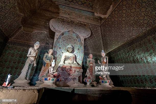 Buddhist statues in Mogao caves The Mogao Caves also known as the Thousand Buddha Grottoes are the best known of the Chinese Buddhist grottoes and...