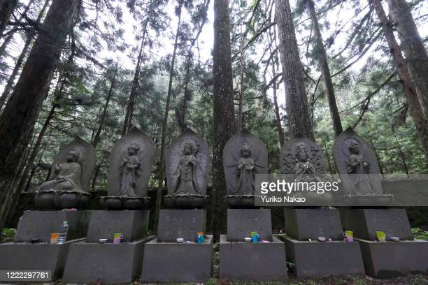 Buddhist stone statues stand at Okunoin cemetery where the mausoleum of Kobo Daishi also known as Kukai the founder of Shingon Buddhism is located on...
