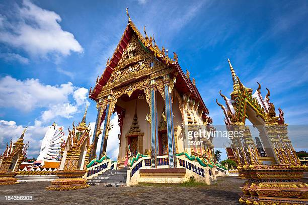buddhist temple against blue sky - ko samui stock photos and pictures