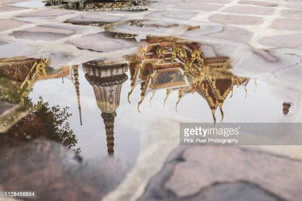 buddhist temple wat pho puddle reflection bangkok thailand - wat pho stock pictures, royalty-free photos & images