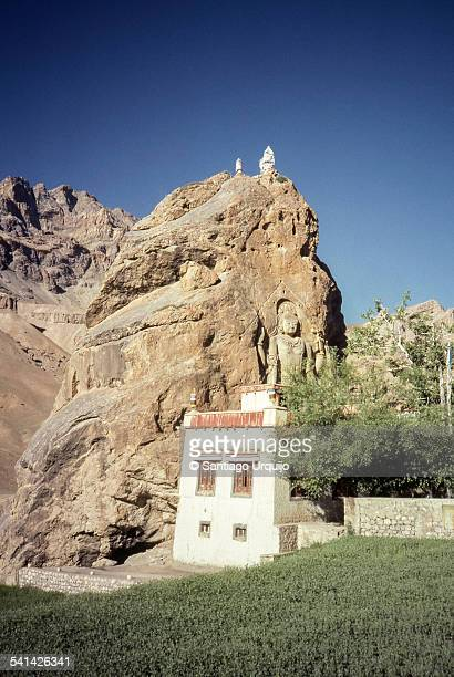Buddhist temple with Buddha carving on rock