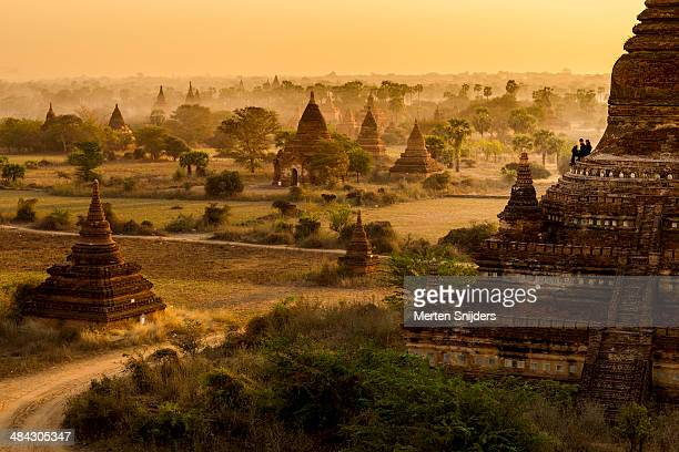 buddhist temples on plain during sunrise - merten snijders stock pictures, royalty-free photos & images