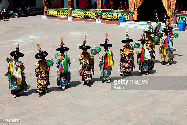buddhist traditional dancers in rumtek monastery sikkim - sikkim stock pictures, royalty-free photos & images
