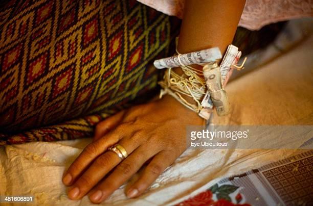 Buddhist wedding ceremony Money attached to wrist