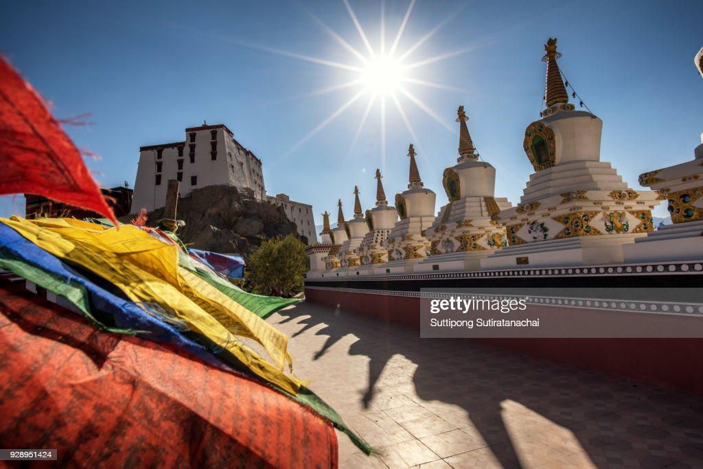 Buddhist white stupa and prayer flag in Thiksey Monastery in Leh , Ladakh, India : Stock Photo