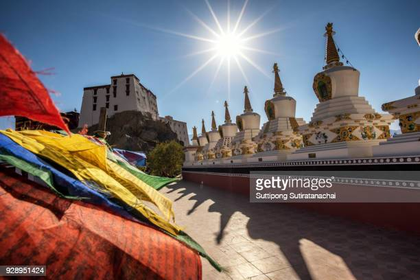 Buddhist white stupa and prayer flag in Thiksey Monastery in Leh , Ladakh, India
