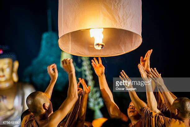 Buddhists after prayer at Borobudur temple for Vesak Day on June 2 2015 in Magelang Indonesia Buddhists in Indonesia celebrate Vesak at the monument...