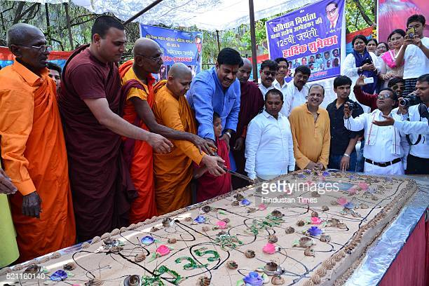 Buddhists and followers cutting a 125 kg cake to celebrate the 125th birth anniversary of Dr BR Ambedkar on April 14 2016 in Bhopal India Bhimrao...