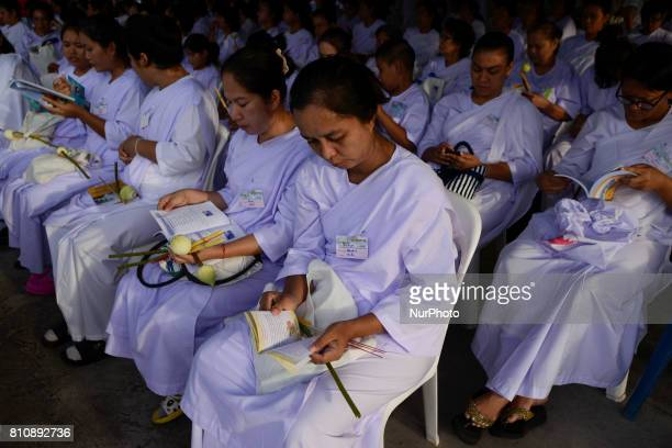 Buddhists believers meditate during a ceremony marking Asalha Puja Day in Wat Asokaram Samut Prakan Thailand 8 July 2017 Asalha Puja brings together...