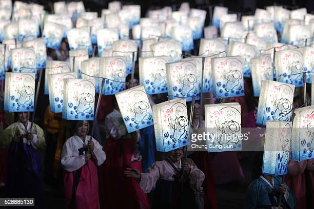 Buddhists carry colorful lanterns as they celebrate the forthcoming birthday of Buddha on May 7, 2016 in Seoul, South Korea. Buddha was born...